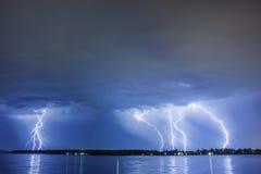 Lighting thunder bolt. Lightning thunder bolt reflected on water Royalty Free Stock Photography