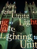 Lighting to Unite. Photo of the National Cathedral at night during a light show in Washington D.C. on May 9 which is called Lighting to Unite. This is part of an royalty free stock photo