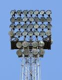 Lighting tower with bright spotlights for illuminating sports fa Stock Photos