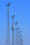 Lighting towers with GSM transmitters. Lighting towers with GSM transmitters on blue background Royalty Free Stock Image