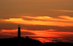 Lighting Trafalgar Lighthouse and sunset, Spain Royalty Free Stock Photo