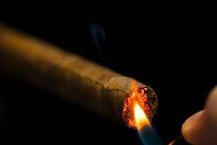 Lighting up a cigar Stock Photo