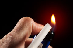 Lighting up a cigarette Stock Images