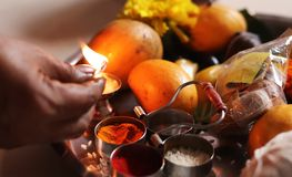Lighting up Flame of Indian Traditional Holy Dish stock image