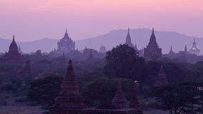 Lighting up pagodas in Bagan valley stock video footage