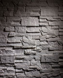 Lighting wall brick. Closeup lighting dark-grey wall brick stock image