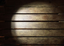 Lighting wood board in darkness use for background. Royalty Free Stock Photos