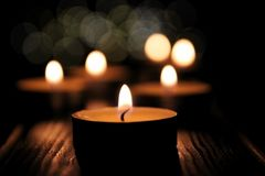 Lightining candles on dark background royalty free stock images