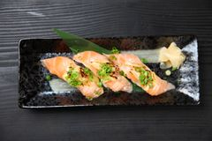 Lightly Broiled Salmon Cheese Sushi. Close Up Shot Of Lightly Broiled Salmon Cheese Sushi on a dining table royalty free stock image