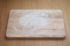 A lightly floured chopping board. A chopping board from above lightly covered in flour Stock Photos