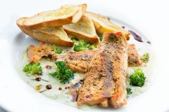Lightly fried salmon with herb sauce Stock Photos