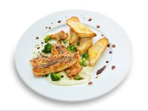 Lightly fried salmon with herb sauce Royalty Free Stock Photos