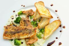 Lightly fried salmon with herb sauce Stock Image
