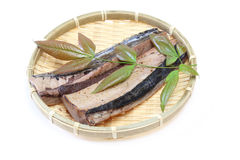 Lightly roasted bonito on a bamboo colander with leaf. Pictured lightly roasted bonito on a bamboo colander with leaf Royalty Free Stock Photos