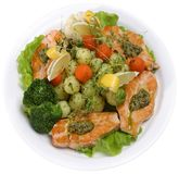 Salmon served with vegetables and greens Royalty Free Stock Photos
