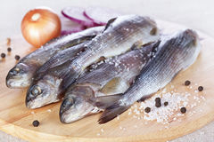Lightly salted grayling. On a chopping board Royalty Free Stock Photos