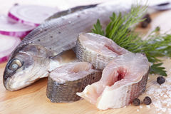 Lightly salted grayling. On a chopping board Royalty Free Stock Images