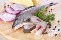 Lightly salted grayling. On a chopping board Royalty Free Stock Photo