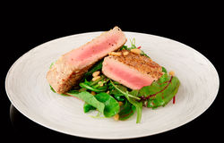 Lightly seared tuna steak and fresh salad Stock Image