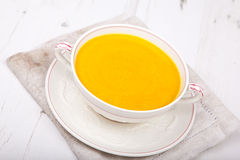 Lightly spiced carrot soup in a bowl, on the white table Stock Photography