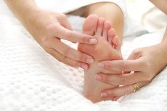 Lightly tickle. Foot massage on white towels Stock Photo