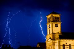 Lightning. Ower the church Stock Photography