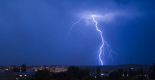 Lightning. A panoramic view of lightning over a city at night Stock Photos