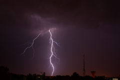 Lightning. A beautiful thunderbolt caught in a stormy summer night Stock Image