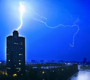 Lightning. Striking the lone tower Stock Images