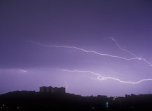 Lightning. Gorgeous lightning strike over a dark landscape Royalty Free Stock Photo