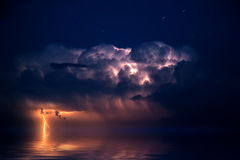 Lightning. Over the sea, storm, night stock photography