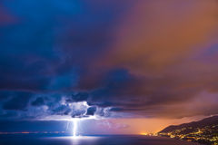 Lightning. Strike over the sea Royalty Free Stock Photos