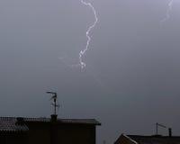 Lightning 3. Lightning over rooftops Stock Photography