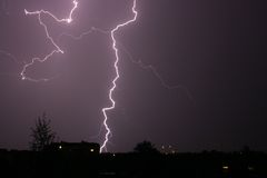 Lightning. At night above city stock photography
