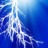 Lightning. On a blue background Stock Photography