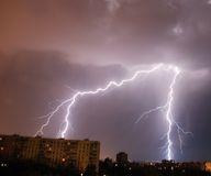 Lightning. In the night over the city Royalty Free Stock Photos