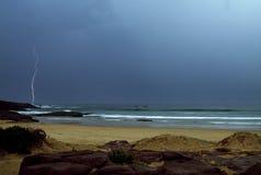 Lightning. Over the ocean with dark sky Stock Photos