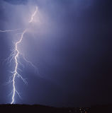 Lightning. Over the landscape in the night Stock Photography