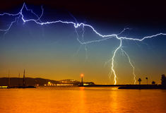 Lightning above the lake Stock Photos