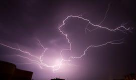 Lightning above the town buildings. Thunder storm and lightning above the town buildings Stock Photo