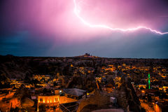 Lightning above the town of Goreme in Cappadocia in Turkey. Dramatic night sky, storm. Stock Images