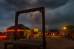 Lightning above a wild west town with gallows. Amazing lightning strike above gallows and a wild west old town in rural Utah, USA Royalty Free Stock Photo