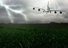 Lightning across and descend aircraft. Royalty Free Stock Images
