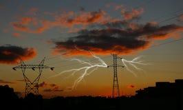 Lightning Arc. Dramatic sunset illustration of power distribution station with lightning striking electricity towers Stock Photo