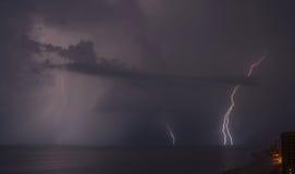 Lightning on the beach. Lightning bolts strike the ocean near gulf shores Stock Photography