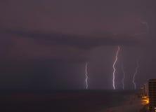 Lightning on the beach. Lightning bolts strike the ocean near gul shores Royalty Free Stock Photos