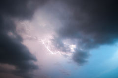 Lightning Bolt in Storm Clouds. Cloud to cloud lightning bolt royalty free stock image
