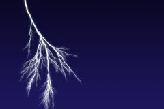 Lightning Bolt. Against dark sky with copyspace on the right Stock Image