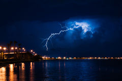 Lightning bolt. Tropical storm over Miami at night with lightning bolt royalty free stock image