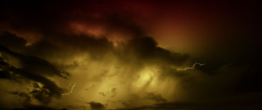 Lightning bolt. Beautiful lightning bolt panoramic duotone with threatening dark clouds royalty free stock photo